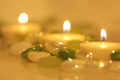 Lit candles & glass beads Royalty Free Stock Photo