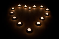 Lit Candles in a Heart Shape Royalty Free Stock Photography