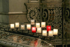 Lit candles inside a church, detail Stock Image