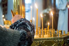 Lit candles in the Orthodox Church on Christmas Eve. stock image