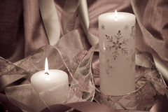 Lit candles and ribbons Stock Image