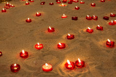 Lit candles on sand in a church to pray for people who died Royalty Free Stock Image