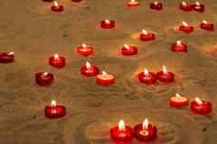 Lit candles on sand in a church to pray for people who died Royalty Free Stock Photo