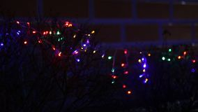 Lit christmas lights. Lit blurred out of focus christmas lights stock footage