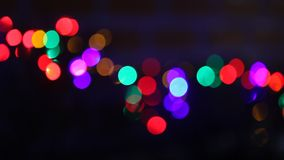 Lit christmas lights. Lit blurred out of focus christmas lights stock video footage