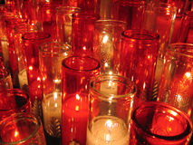 Lit church candles. White and red church candles at Notre Dame Cathedral, Old Port, Montreal Royalty Free Stock Image