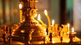 Lit church candles on the spike. Lit church candles on the spike stock video footage