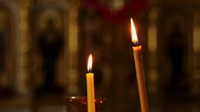 Lit church candles on the spike. Lit church candles on the spike stock footage