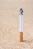 Lit cigarette. On marble with space for text Stock Photos