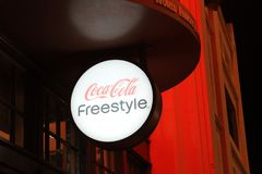 Lit Coca-Cola freestyle sign at night royalty free stock images