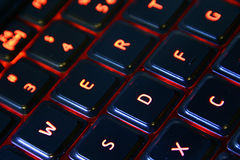 Lit computer Keyboard. A macro image orange back lit computer keyboard Stock Images