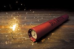 Lit dynamite stick on the floor Royalty Free Stock Photography