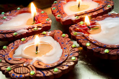 Lit earthenware diyas for Diwali. Lit earthenware wax diyas. These are handmade and lit to celebrate the hindu festival of Diwali Royalty Free Stock Photography