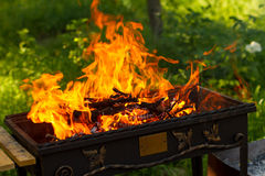 Lit a fire in the grill. Flames in the grill, Outdoors Stock Photography