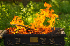 Lit a fire in the grill. Flames in the grill, Outdoors Royalty Free Stock Image