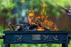 Lit a fire in the grill. Flames in the grill, Outdoors Royalty Free Stock Photos