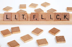 'Lit Flick' spelled with Scrabble tiles Stock Photo