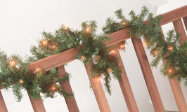 Lit garland on rail Stock Image
