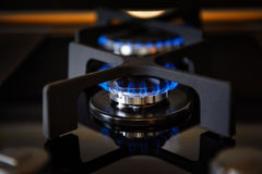 Lit gas burner on a glass plate closeup Royalty Free Stock Photography
