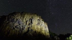 Lit granite rock with stars Royalty Free Stock Images