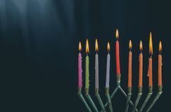 The lit of hanukkah candles in menorah on blue background. The lit of hanukkah candles in a menorah on blue background stock photo