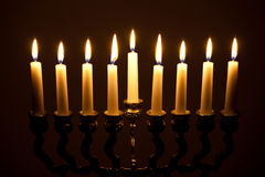Lit hanukkah menorah on black Stock Image