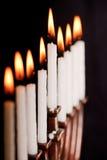 Lit hanukkah menorah on black background. Royalty Free Stock Photos