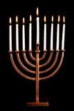 Lit hanukkah menorah black background. Royalty Free Stock Photos