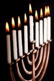 Lit hanukkah menorah black background. Royalty Free Stock Image