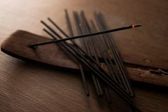 Lit incense stick royalty free stock photo