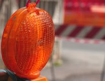 Lit lamp for the roadworks as distress signal Stock Photo