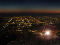 Lit lamp on rock mountain with city night view Royalty Free Stock Photo