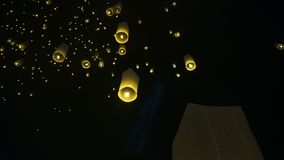 Lit Lantern floating with other thousands on full moon night Thailand