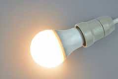 Lit LED light bulb. Lit up light bulb with light-emitting diode technology of warm light royalty free stock photo