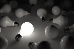 Lit light bulb. One lit light bulb amongst other broken light bulbs Stock Illustration