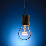 A lit light bulb Royalty Free Stock Photo