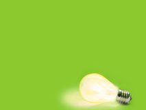 Lit lightbulb. Green Background with lit lightbulb Royalty Free Stock Image