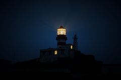 Lit Lighthouse at Night Royalty Free Stock Images