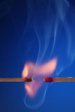 Lit matchstick next to an unlit matchstick Stock Image