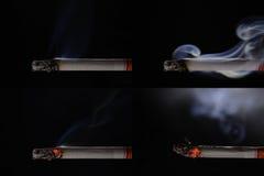 Lit och brinnande cigarett med rök royaltyfri foto