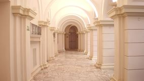 Lit old building passageway and columns. Lit passageway and multiple columns Royalty Free Stock Photography