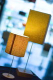 Lit orange lamps. Two orange lit lamps in a lamp shop Stock Images
