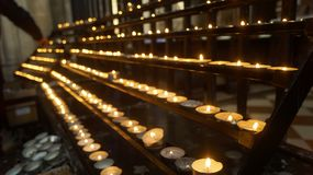 Lit prayer candles royalty free stock images