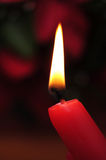 Lit red candle Stock Photo