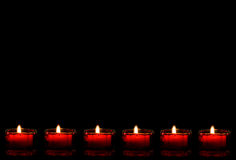 Lit red candles as bottom border Royalty Free Stock Image