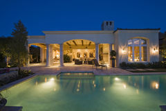 Lit Swimming Pool And Building Exterior. At night Royalty Free Stock Photography