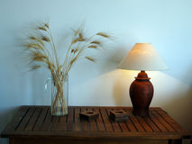 Lit table lamp and wheat Stock Photography