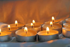 Lit Tea Candle. This photo shows some lit tea candles Royalty Free Stock Photo