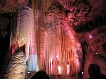Lit-up draperies in Meramec Caves, Stanton, Missouri. Bright lights of red, white and blue, enhance the draperies in the Meramec Caves, Stanton, Missouri stock image