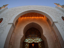 Lit up facade of grand mosque Stock Image